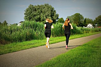 Two women jogging in the countryside