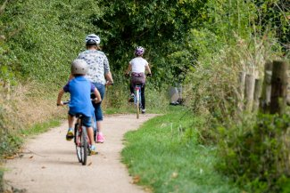 Family cycling along the Greenway