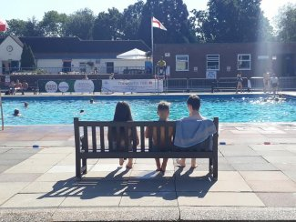 Children on a bench at Letchworth's outdoor pool