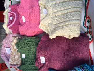 Knitted jumpers made by a local Letchworth group