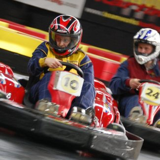 Two go-karts going round a track
