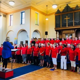 Letchworth  City Chorus practice in a church hall