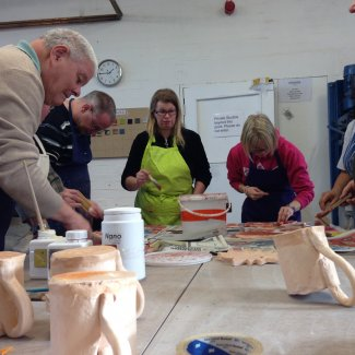 Members of Jackie's Drop-In firing clay with Digswell Arts Trust