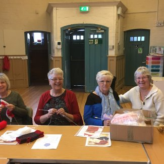 Knit and Natter group members in Mrs Howard Hall, Letchworth