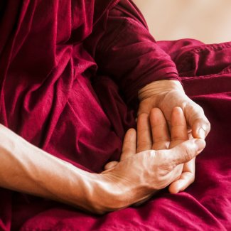 Hands in lap in meditative pose