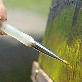 Paint being applied to a canvas