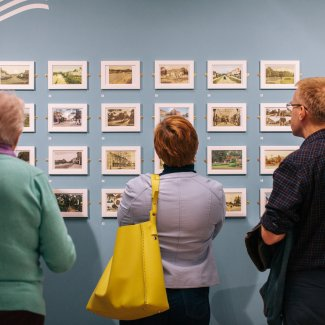 Group of people viewing gallery exhibition
